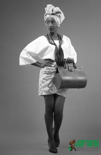 Wearing Tabeeta fashion Affair and bag by Okiki Marinho
